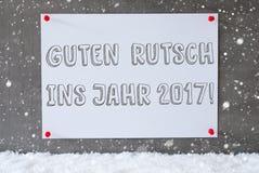 Etichetta, parete del cemento, fiocchi di neve, nuovo anno di mezzi di Guten Rutsch 2017 Immagine Stock