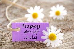Etichetta porpora con felice il quarto luglio Fotografie Stock