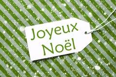 Etichetta su Libro Verde, fiocchi di neve, Joyeux Noel Means Merry Christmas Fotografie Stock Libere da Diritti