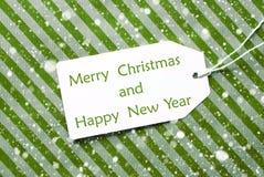 Etichetta su Libro Verde, sui fiocchi di neve, sul Buon Natale e sul nuovo anno Fotografie Stock Libere da Diritti