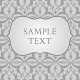 Etichetta sul fondo grigio del damasco Fotografie Stock