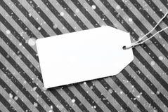 Etichetta sullo spazio nero della copia e della carta da imballaggio, fiocchi di neve Immagine Stock