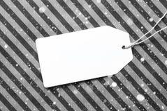 Etichetta sullo spazio nero della copia e della carta, fiocchi di neve Immagine Stock