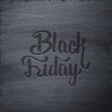 Etichetta tipografica di vendita di Black Friday sulla lavagna Fotografie Stock