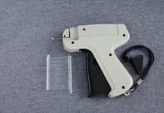 Etichettatura della pistola del panno Immagini Stock