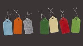 Etichette del regalo isolate su fondo nero Etichette di vendita Immagini Stock