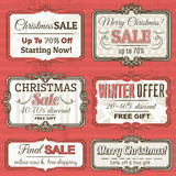 Etichette di Natale con l'offerta di vendita, vettore Immagini Stock