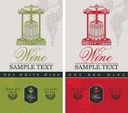 Etichette per vino con un torchio e un barilotto illustrazione di stock
