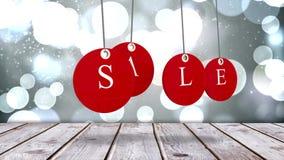 Etichette rosse di vendita che appendono contro il fondo d'ardore royalty illustrazione gratis