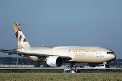 Etihad Cargo plane taxiing in Amsterdam Airport Schiphol AMS. Etihad Airways Cargo plane doing taxi in AMS Airport royalty free stock photo