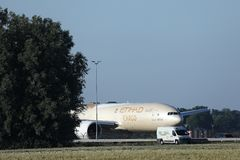 Etihad Cargo plane taxiing in Amsterdam Airport Schiphol AMS. Etihad Airways Cargo plane doing taxi in AMS Airport stock photo