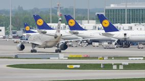 Etihad plane taxiing to terminal, Munich Airport, MUC. Etihad jet taxiing on Munich Airport, MUC, Germany stock video