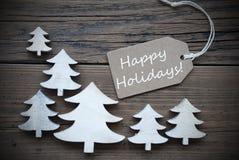 Etiket en Kerstbomen met Gelukkige Vakantie Royalty-vrije Stock Foto