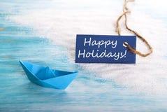 Etiket met Gelukkige Vakantie en Boot stock afbeelding