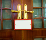 Etiket op deurhandvat Stock Foto's