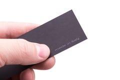 Etiketfabrikant in een mannelijke hand stock foto's