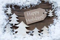 Etiketkerstbomen en Sneeuw Gelukkige Vakantie Royalty-vrije Stock Foto's