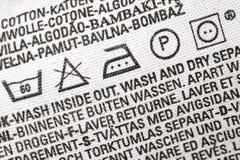 etikett för rådgivningklädtvätteri Arkivbilder