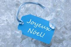 Etikett på is med Joyeux Noel Mean Merry Christmas Royaltyfri Foto