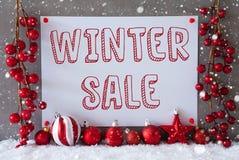 Etikett snöflingor, julbollar, textvinter Sale Arkivfoton