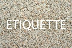 Etikette - Wort auf Steinhintergrund als freiem Raum für Entwurf lizenzfreies stockfoto