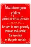 Etiketten i thailändsk tempel Arkivbild
