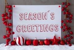 Etiketten snö, julbollar, text kryddar hälsningar Arkivbilder