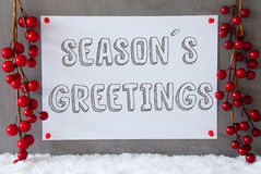 Etiketten snö, julgarnering, text kryddar hälsningar Arkivfoto