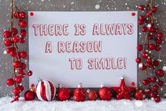 Etiketten snöflingor, julbollar, citerar alltid anledning att le Arkivbilder