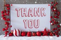 Etiketten snöflingor, julbollar, text tackar dig royaltyfria foton