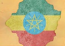 Etiopien flaggaabstrakt begrepp i betong för agg för fasadstruktur stor skadad Royaltyfri Foto