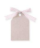 Etiqueta abstracta del regalo del modelo con la cinta roja del punto (con el camino de recortes Imagen de archivo libre de regalías