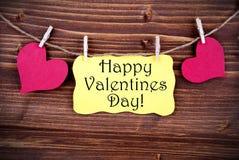 Etiqueta amarela com dia de Valentim feliz imagens de stock royalty free