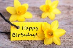 Etiqueta amarela com feliz aniversario fotos de stock