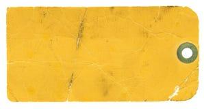 Etiqueta amarilla en blanco en el fondo blanco Fotografía de archivo