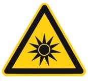 Etiqueta amonestadora de la etiqueta engomada de la muestra del texto de radiación del peligro de la precaución del peligro óptic Fotos de archivo