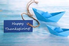 Etiqueta azul con acción de gracias feliz Imagen de archivo