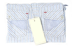 Etiqueta blanca en la camisa Foto de archivo libre de regalías
