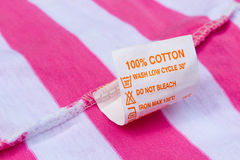 Etiqueta cem por cento de algodão Fotografia de Stock Royalty Free