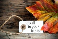 Etiqueta com as palavras seu tudo da queda em suas mãos Imagens de Stock