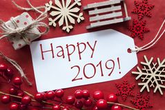 A etiqueta com a decoração do Natal, Text 2019 feliz fotografia de stock royalty free