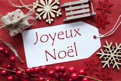 Etiqueta com a decoração, Joyeux Noel Means Merry Christmas Fotografia de Stock