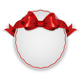 Etiqueta con el arco rojo Fotos de archivo libres de regalías