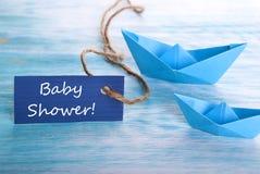 Etiqueta con la fiesta de bienvenida al bebé imagenes de archivo