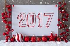 Etiqueta, copos de nieve, bolas de la Navidad, texto 2017 Foto de archivo libre de regalías