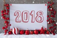 Etiqueta, copos de nieve, bolas de la Navidad, texto 2018 Foto de archivo libre de regalías
