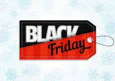 Etiqueta das vendas de Black Friday no fundo do floco de neve Fotografia de Stock Royalty Free