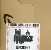Etiqueta de advertencia de la batería imagen de archivo