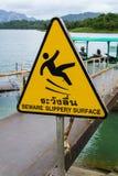 Etiqueta de advertencia superficial resbaladiza Foto de archivo