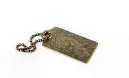 Etiqueta de cobre amarillo del oro vacío del metal aislada en blanco imagenes de archivo